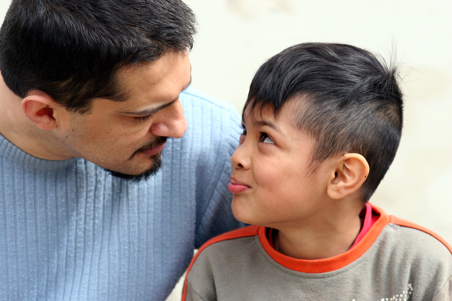 Photo of father and child talking